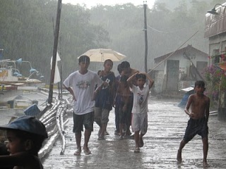 image of rural folks walking in the rain