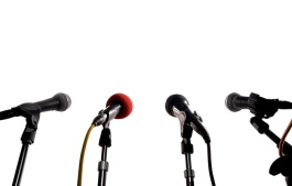 image of microphones set up around a lectern during press conference