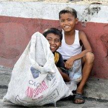 Image of urban poor boys taking a rest in between scavenging plastics